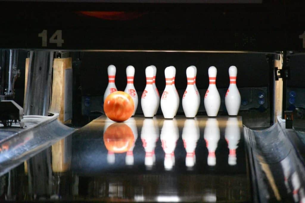 bowling ball hitting just 2 pins on left